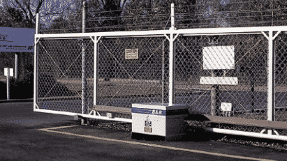 Security gate with barbed wire